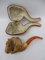 Lot 35 - A good quality cased meerschaum pipe, the bowl ornately carved as a horse head.