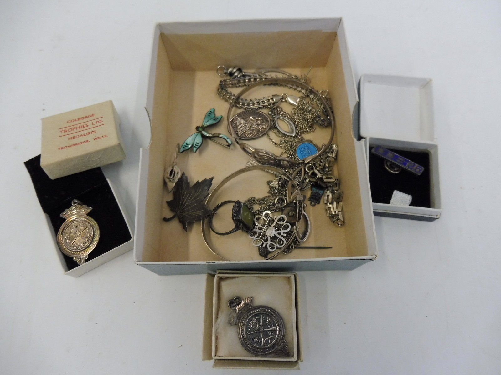 Lot 49 - A small box of mixed silver to include medallions, bangles etc.