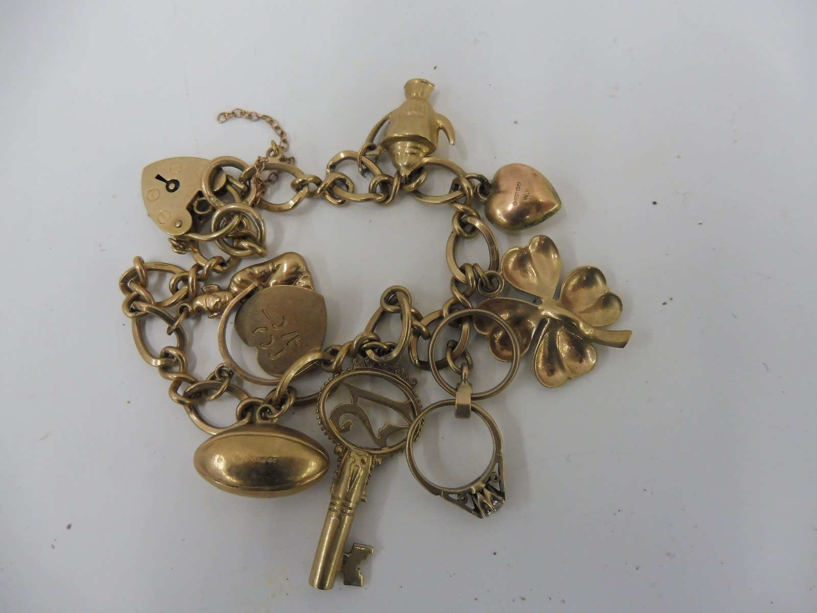 Lot 1 - A 9ct gold charm bracelet.