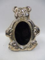 Lot 30 - A contemporary silver fronted easel photograph frame in the shape of a teddy bear