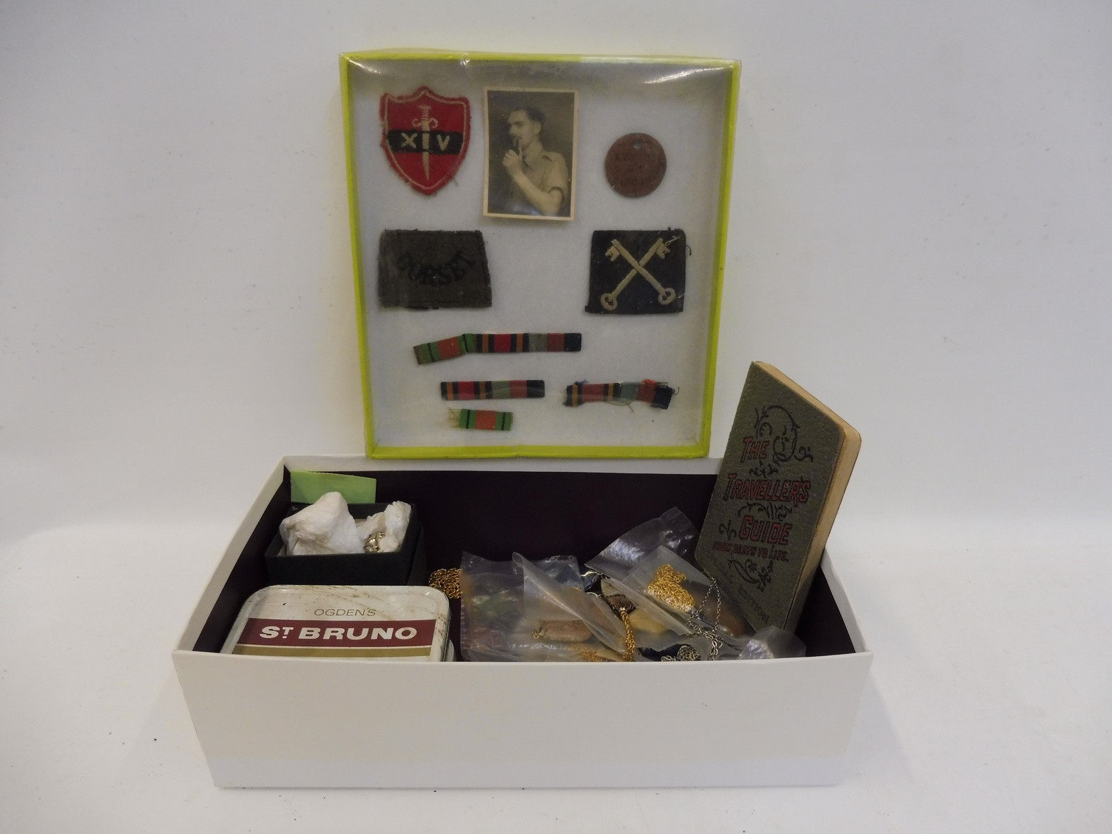 Lot 57 - A box of mixed jewellery and a group of military ribbons, insignia etc.