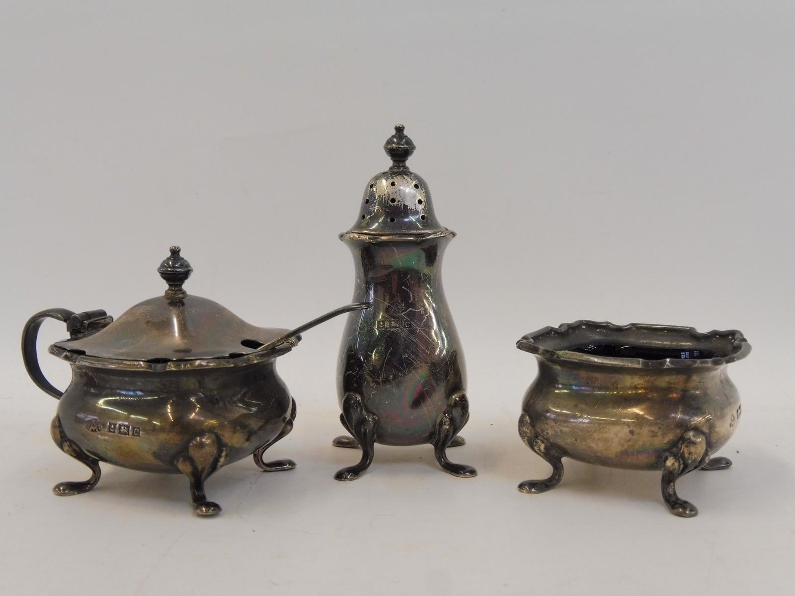 Lot 56 - A silver three piece cruet set, Birmingham.