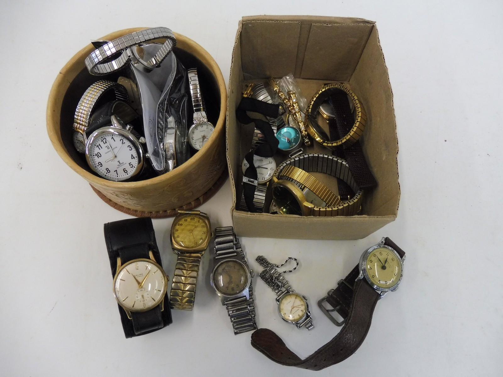 Lot 48 - Two small boxes of wristwatches.