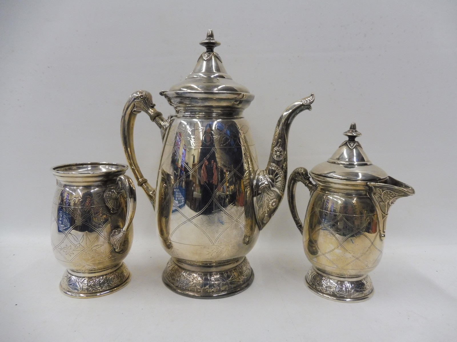 Lot 42 - An American silver plated three piece tea set.