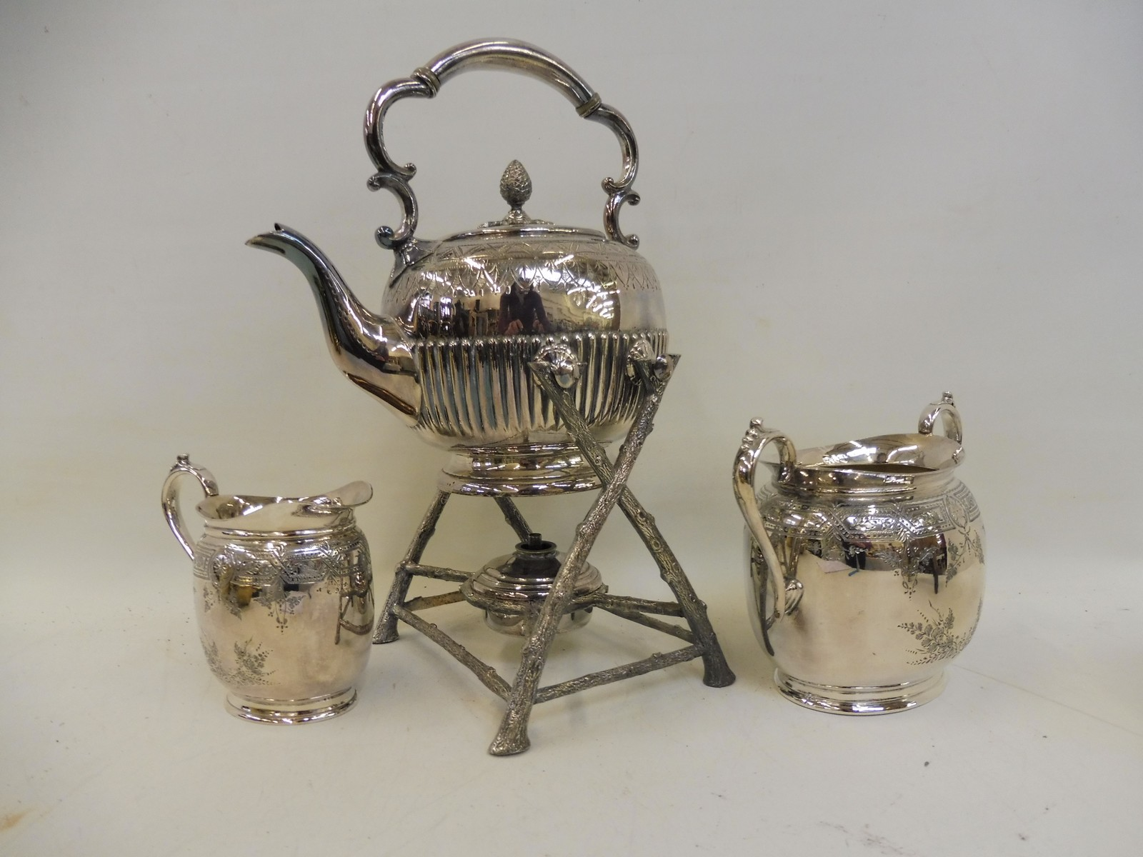 Lot 23 - A late Victorian silver plated spirit kettle on stand, and a silver plated sugar bowl with milk