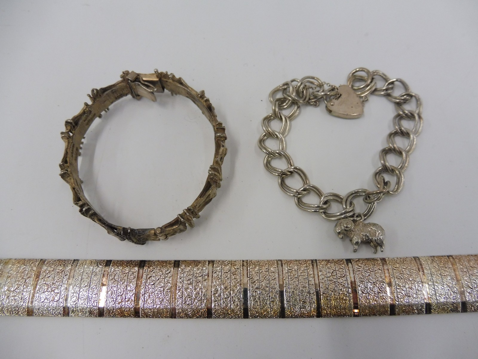 Lot 14 - A naturalistic silver bracelet and two others.