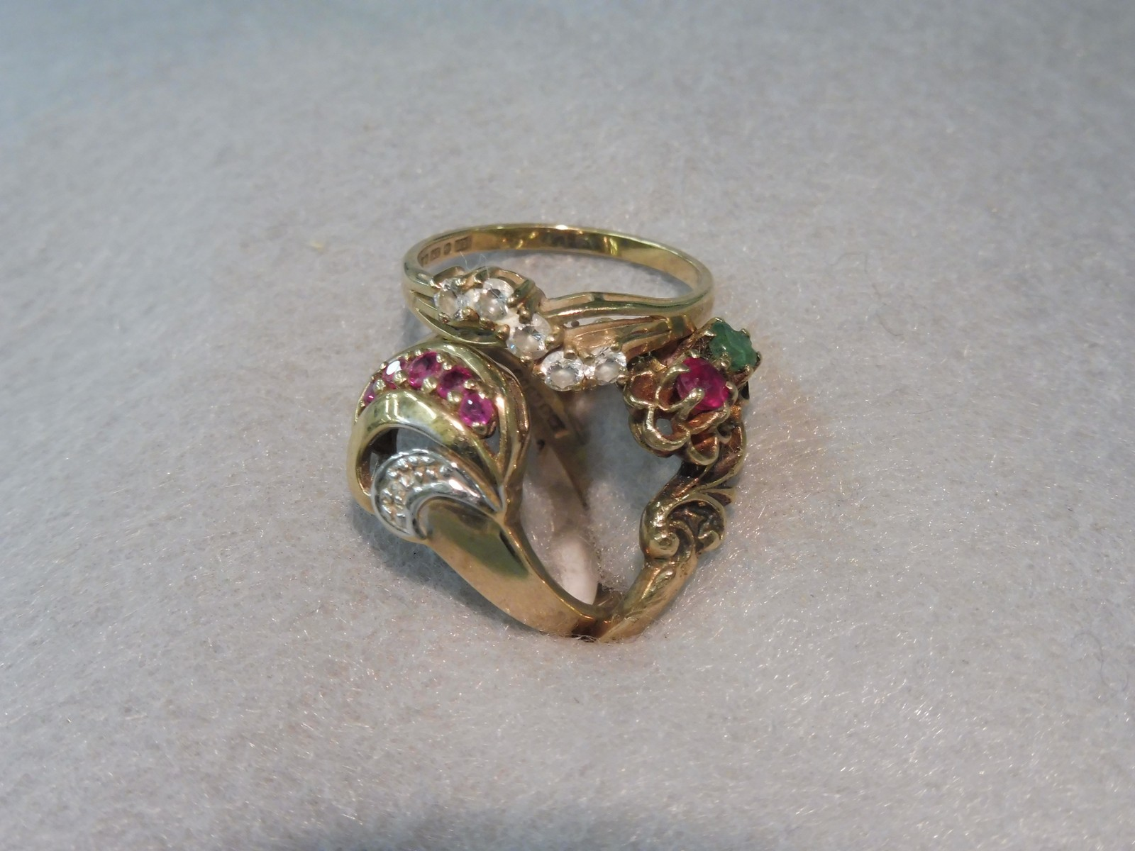 Lot 11 - Three 9ct gold rings set with various stones.