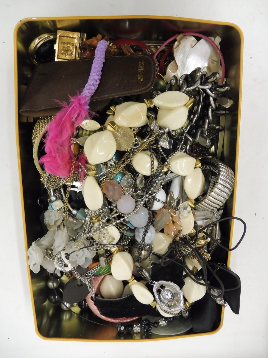 Lot 59 - A tin of assorted costume jewellery.