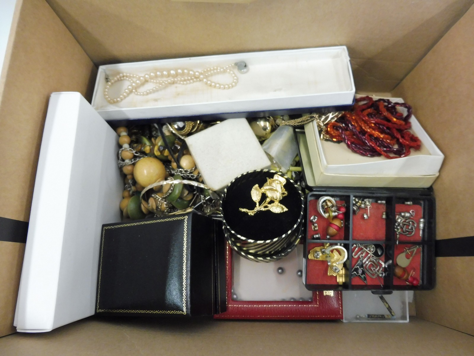 Lot 47 - A box of assorted costume jewellery.