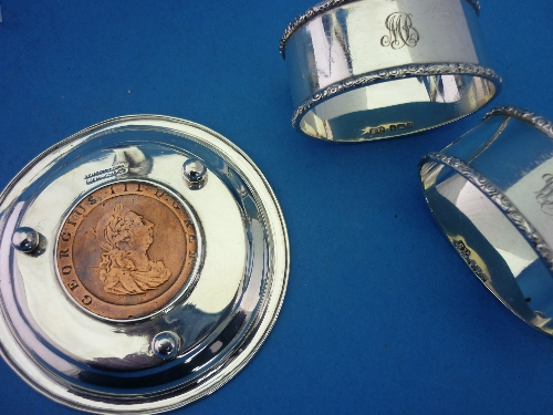Lot 32 - A pair of George VI silver oval shaped Napkin Rings, hallmarked Birmingham, 1939, monogrammed,