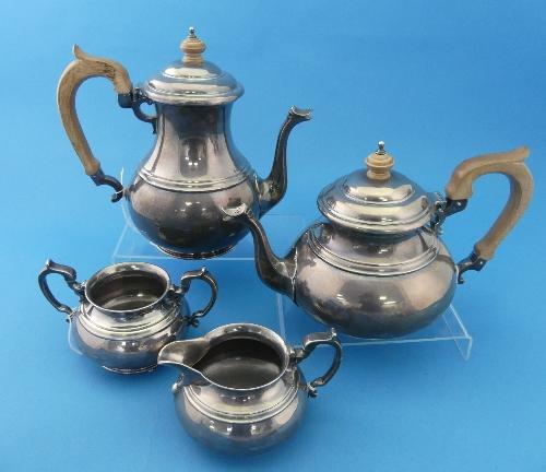 Lot 57 - An Elizabeth II silver four piece Tea Set, by Edward Barnard & Sons Ltd, retailed by Bruford's of
