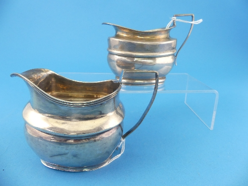 Lot 35 - A George III silver Cream Jug, hallmarked London, 1809, together with a smaller Victorian silver