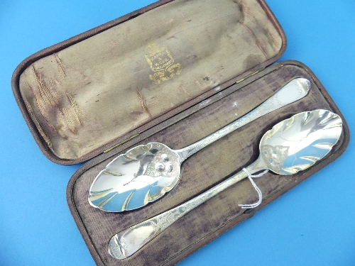 Lot 8 - A near matched cased pair of Victorian silver Serving Spoons, hallmarked London, 1853 and 1847,