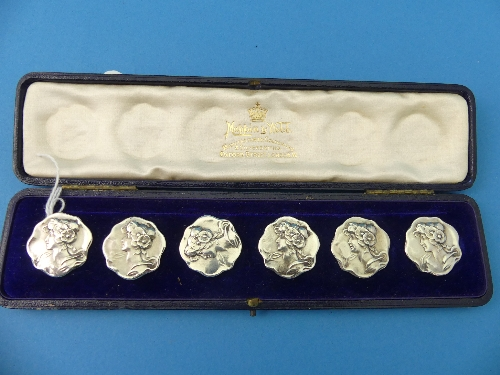 Lot 27 - A cased set of six Edwardian silver Buttons, two by Mappin & Webb, four by Henry Matthews,