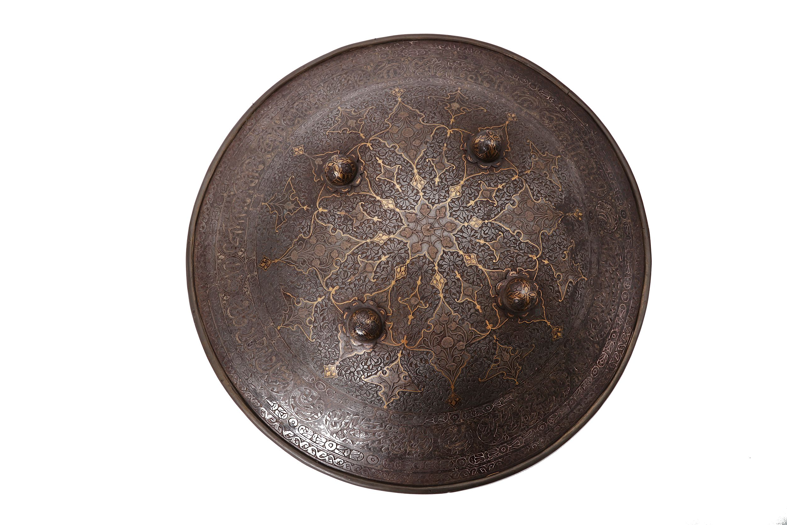 Lot 40 - A QAJAR GOLD-DAMASCENED AND SILVER-INLAID STEEL HELMET, SHIELD AND ARMGUARD.