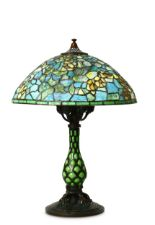Lot 32 - A TIFFANY STYLE BRONZE TABLE LAMP.