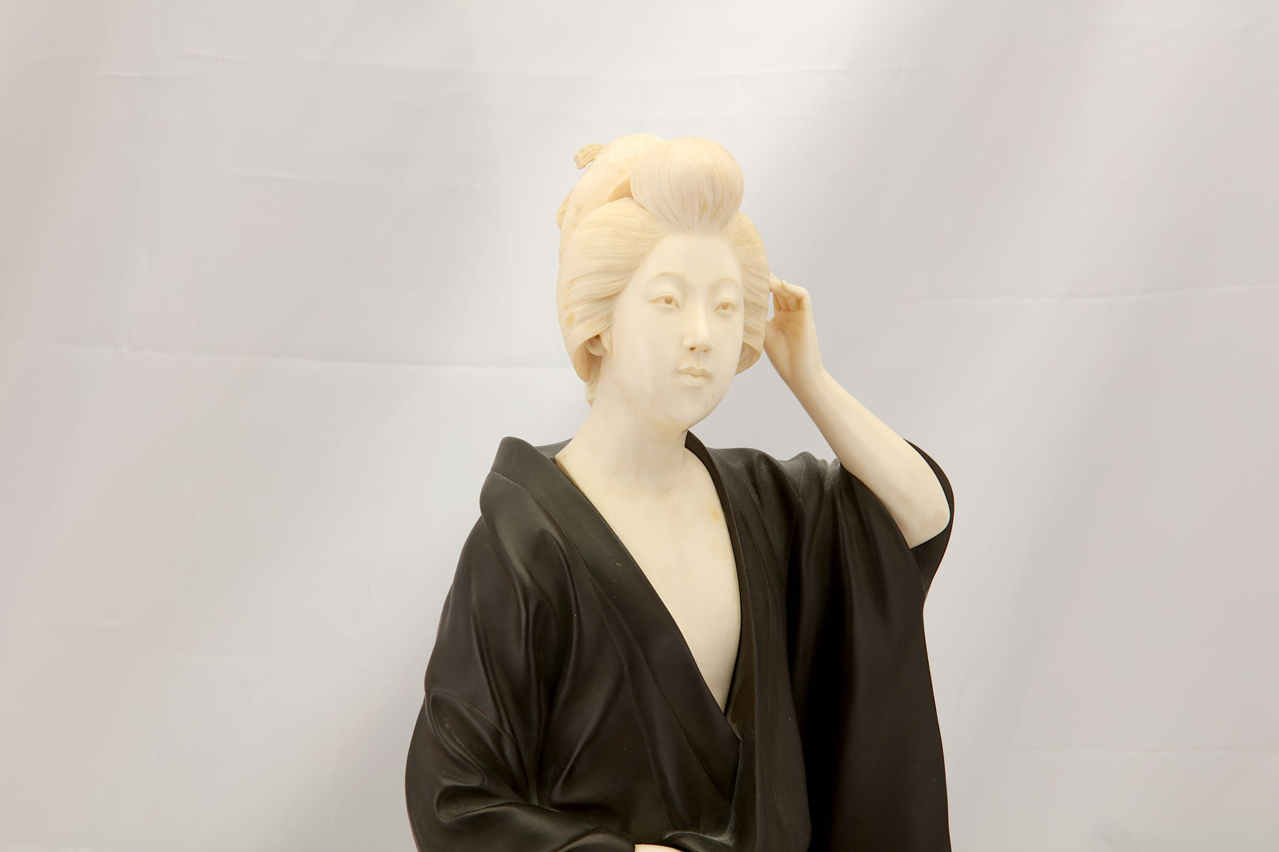 Lot 58 - A LARGE JAPANESE BRONZE AND IVORY FIGURE OF A BEAUTY.