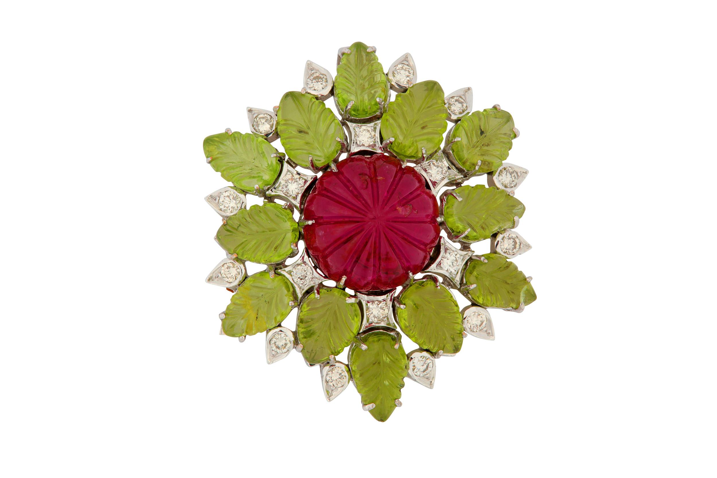 Lot 47 - A pink tourmaline, peridot and diamond pendant