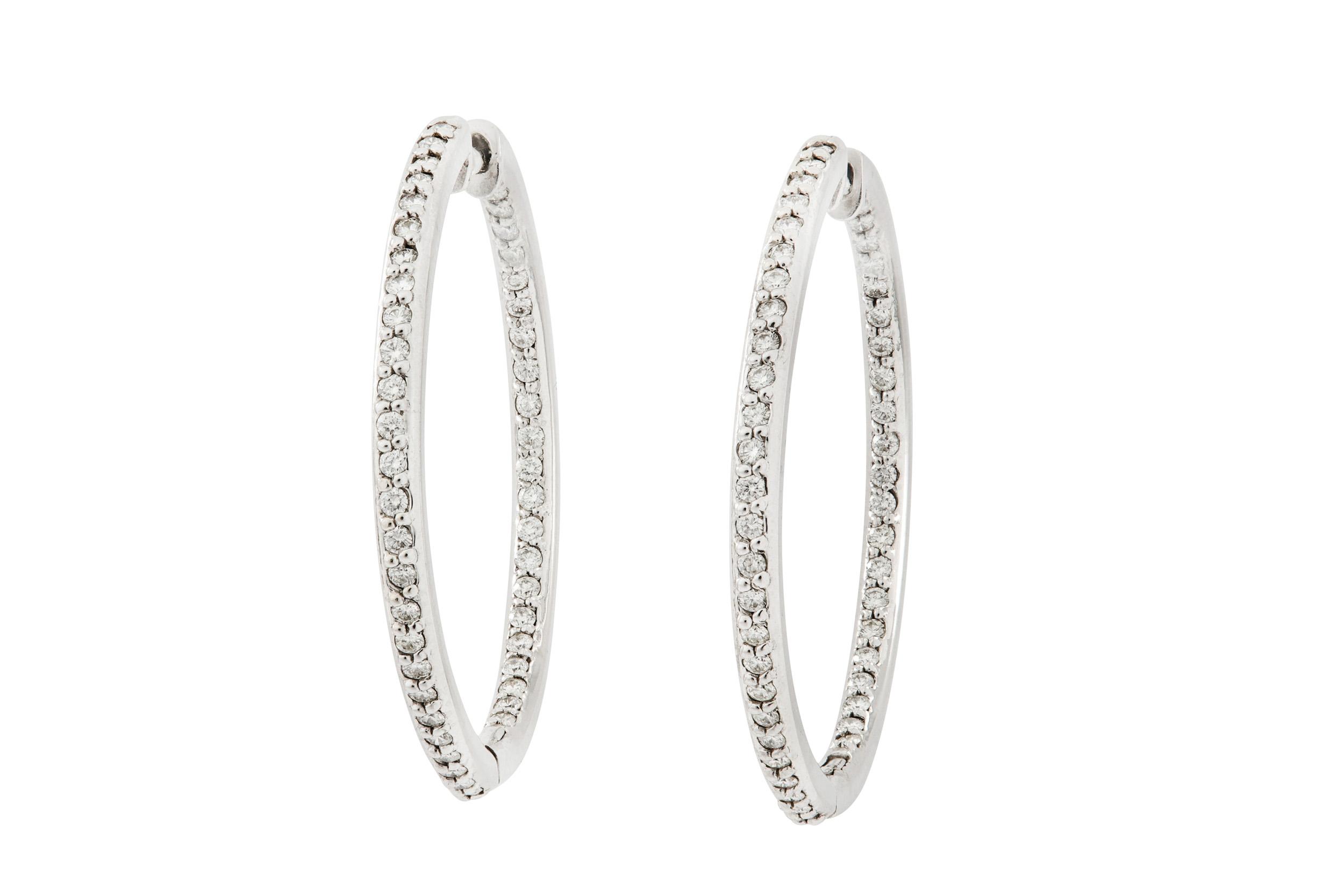 Lot 31 - A pair of diamond hoop earrings