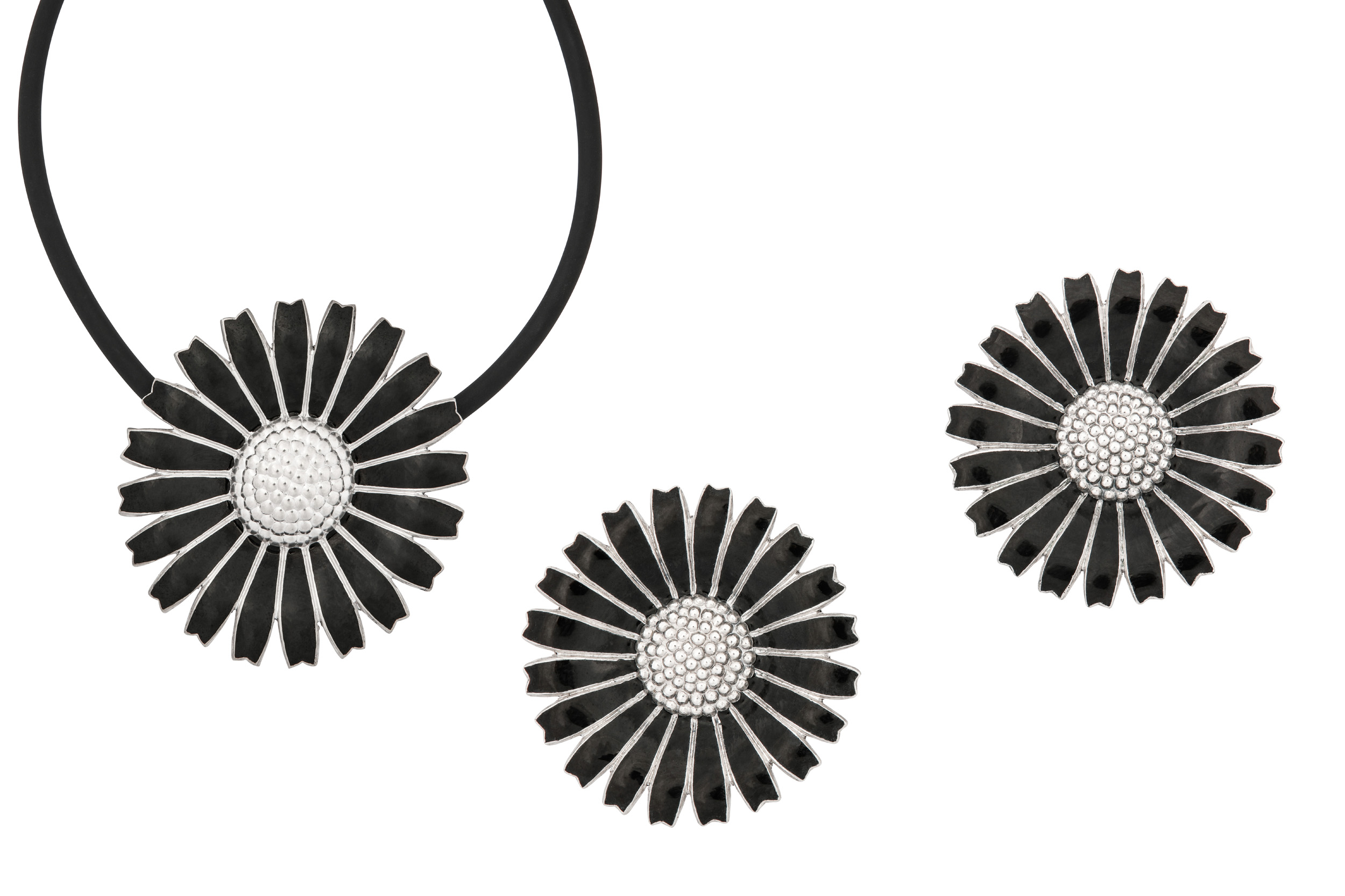 Lot 56 - A black enamel 'Daisy' pendant and earclips, by Georg Jensen