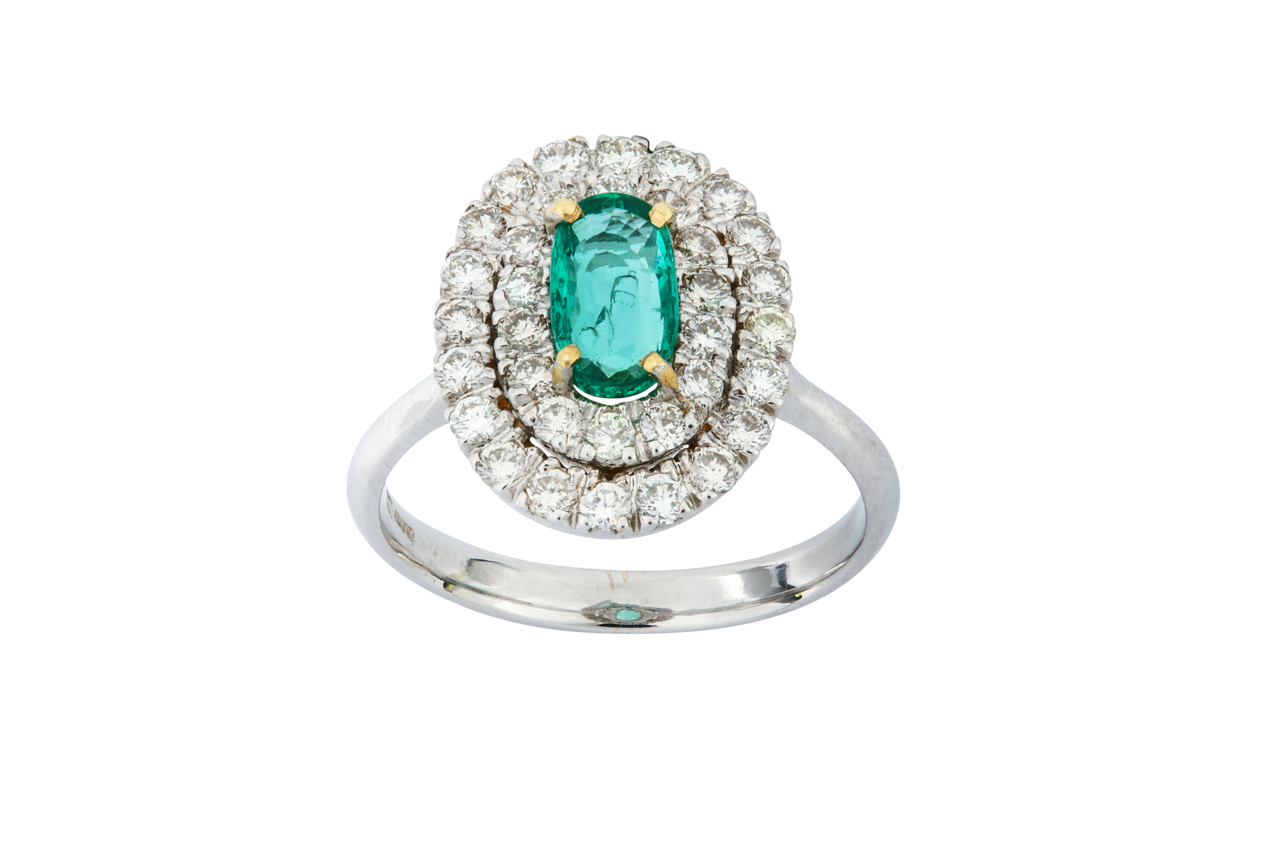 Lot 12 - An emerald and diamond ring