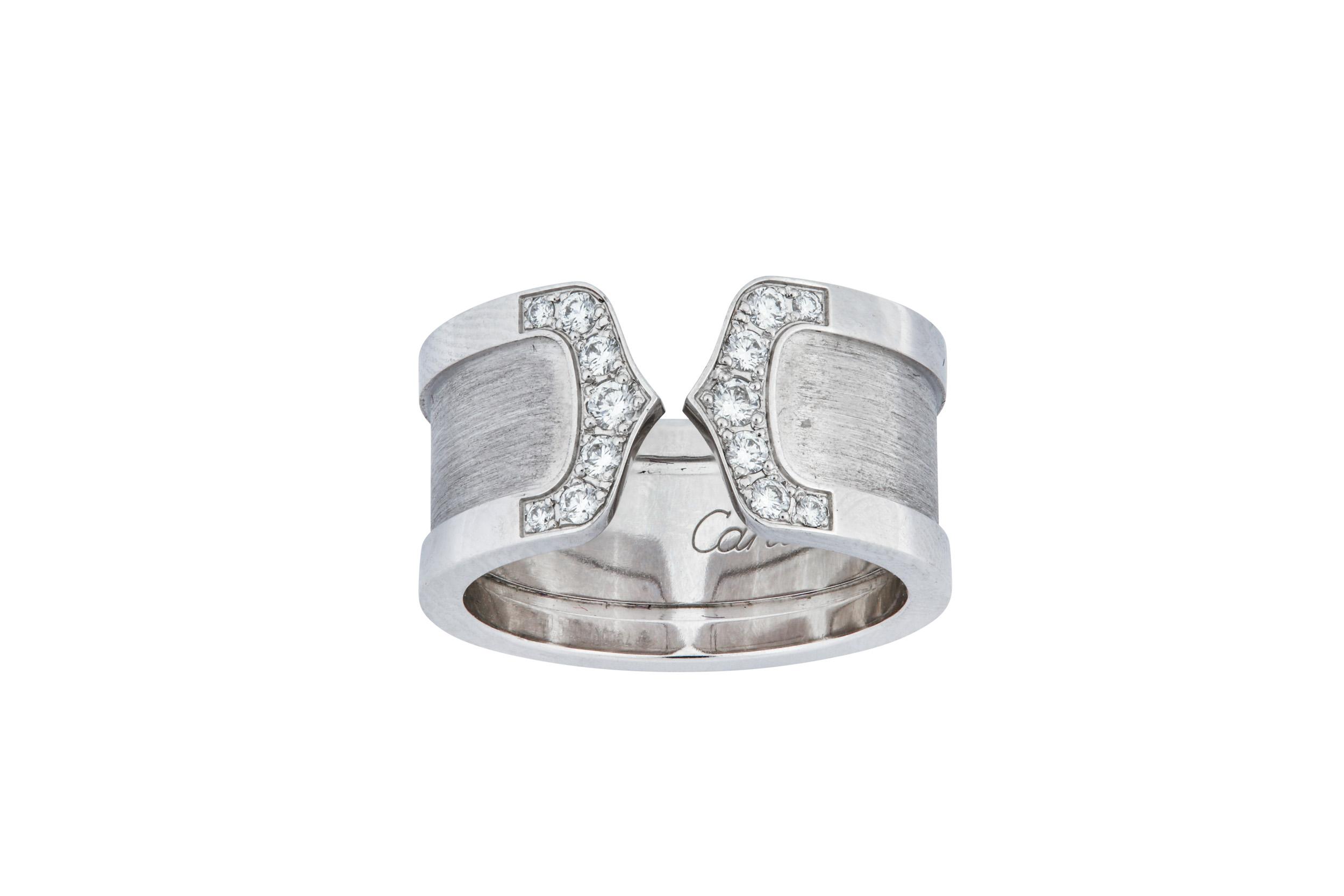 Lot 10 - A diamond-set 'Logo' ring, by Cartier