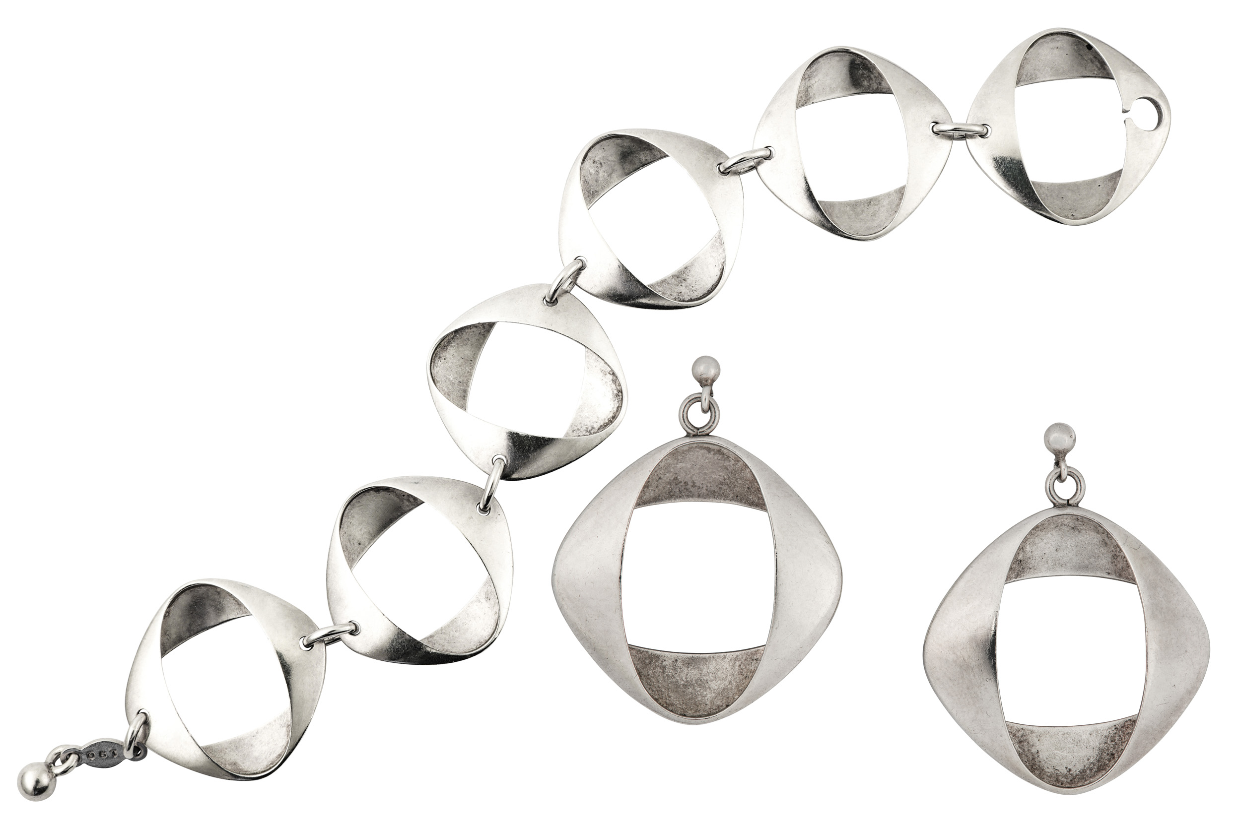 Lot 60 - A bracelet and earrings suite, by Henning Koppel for Georg Jensen