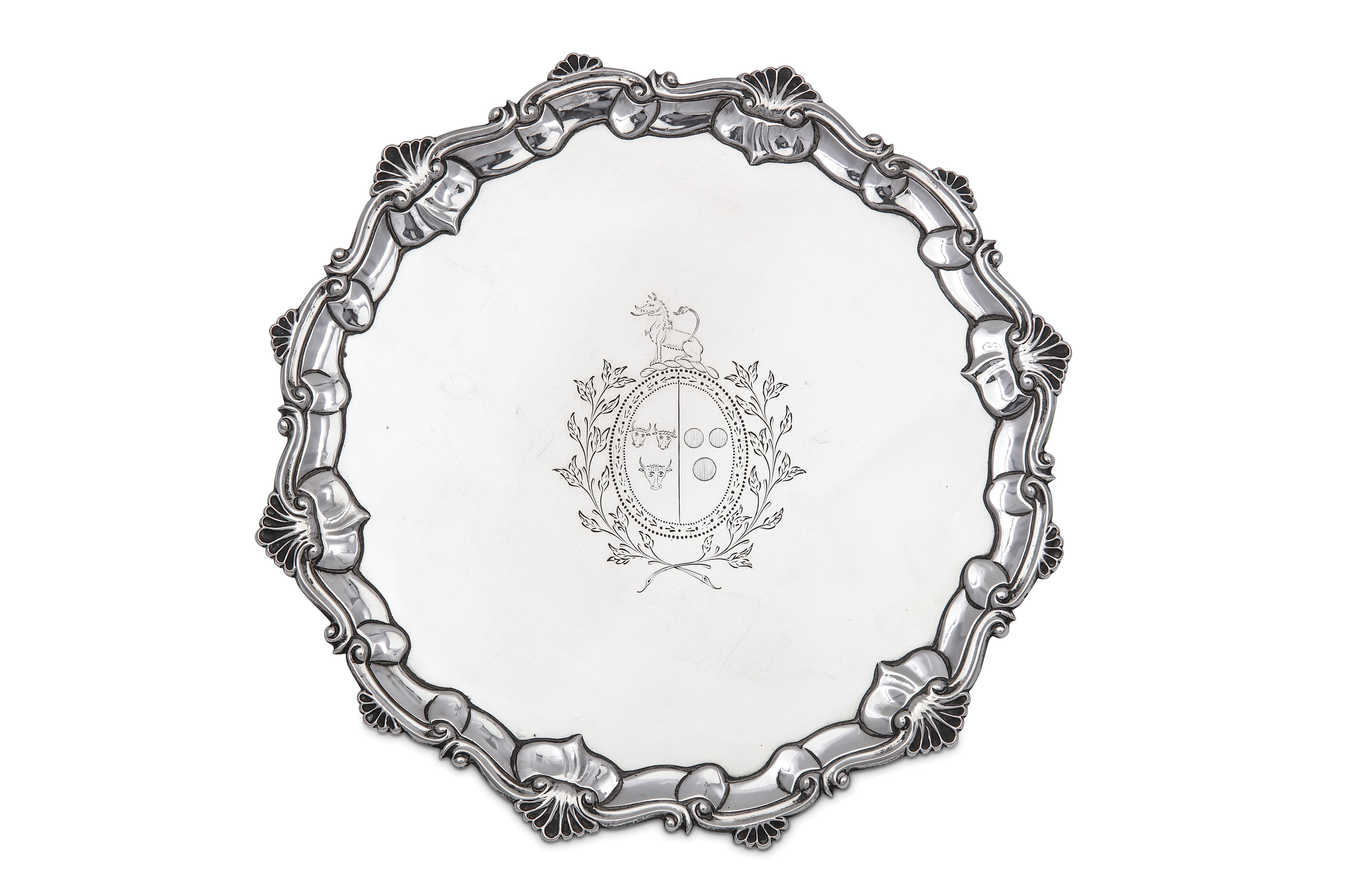 Lot 47 - A George III sterling silver salver, London 1765 by T.H over I.C indented, probably for Thomas Hanna