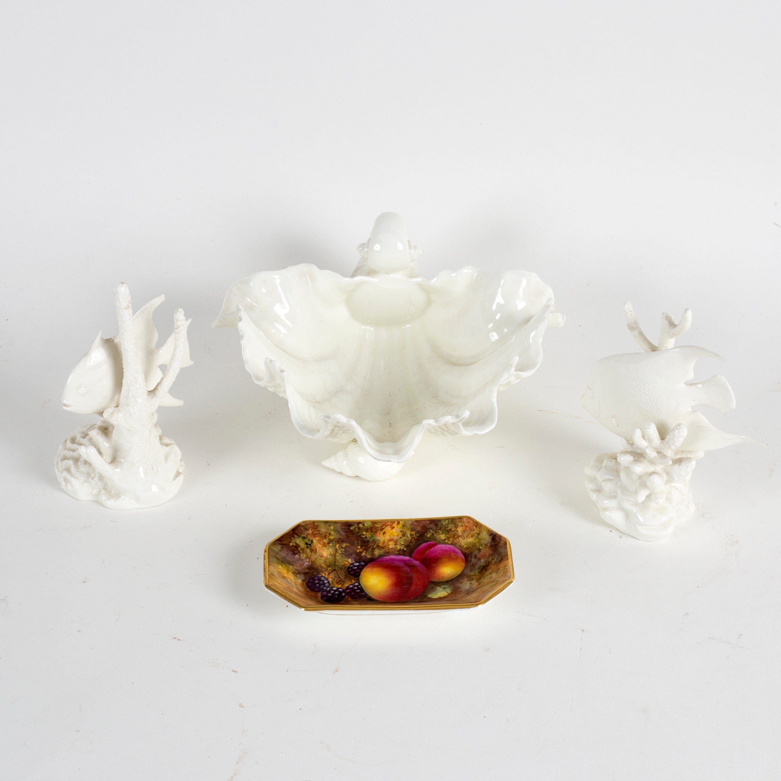 Lot 219 - A Royal Worcester dish of shell form on three shell feet, 18.