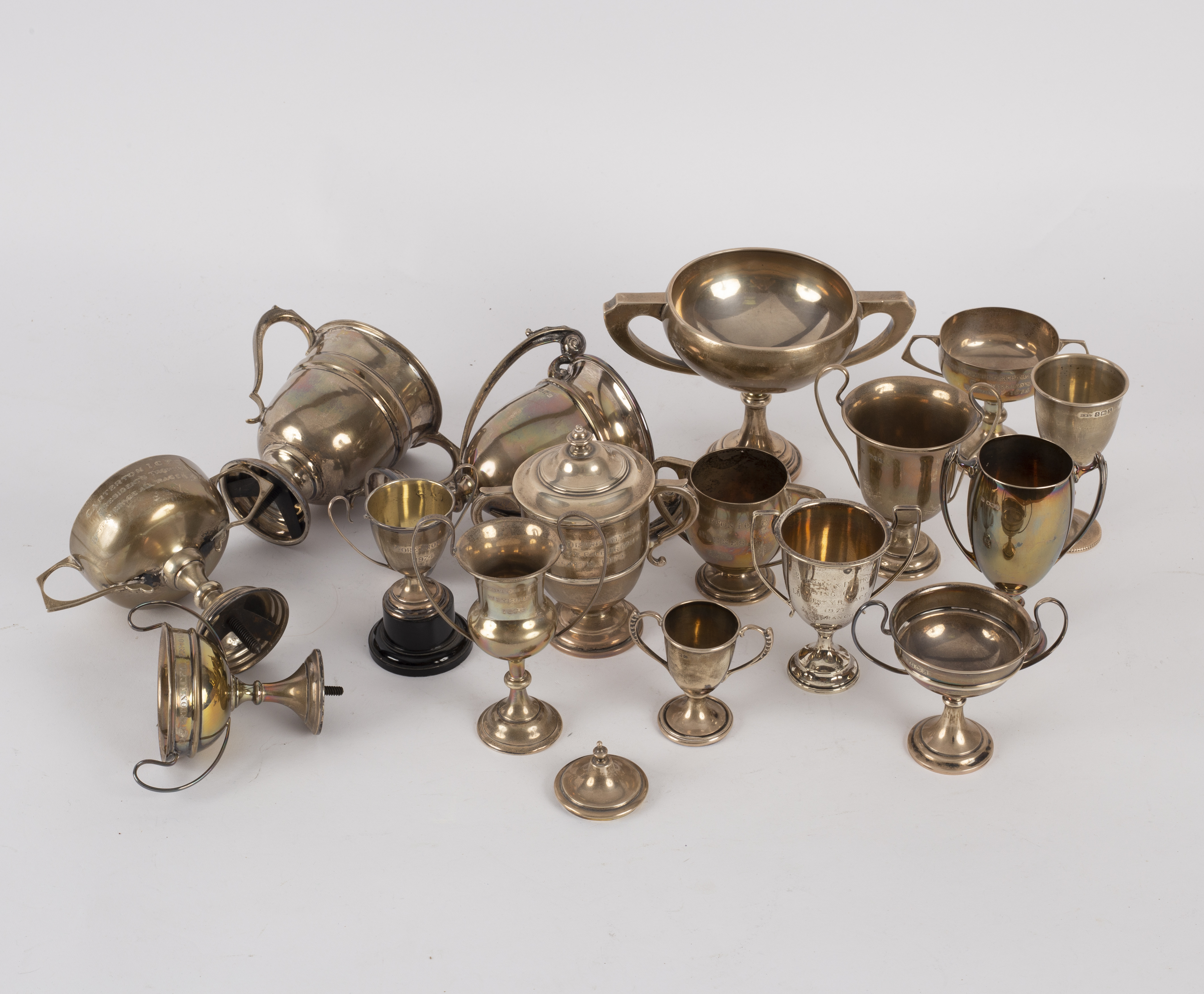 Lot 114 - A collection of silver trophy cups,