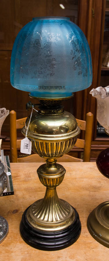 Lot 701 - BRASS OIL LAMP WITH SHADE