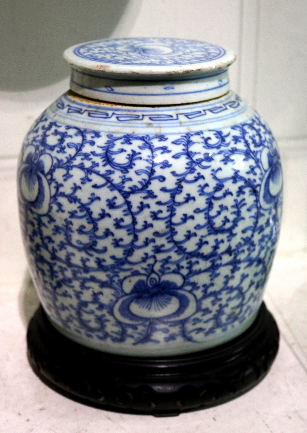 Lot 5083 - Chinese underglazed blue porcelain lidded jar, the rounded body decorated with floral tendrils, with