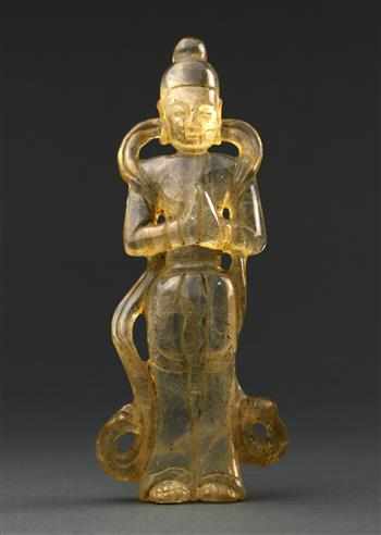 Lot 5030 - Chinese rock crystal carving, of a standing deity draped in celestial scarf, with hands clasped