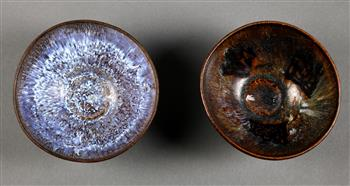 Lot 5025 - (lot of 2) Chinese Jian-type ceramic bowls, one with blue-white hue to the interior; the other