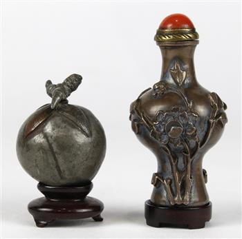 Lot 5055 - (lot of 2) Chinese metal snuff bottles, the first a peach form pewter bottle; the second, of