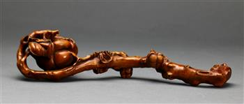 Lot 5057 - Chinese boxwood ruyi scepter, the head carved with a large persimmon issuing from the scepter in the