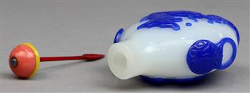 Lot 5054 - Chinese blue overlay white glass snuff bottle, 19th/early 20th century, both sides featuring a