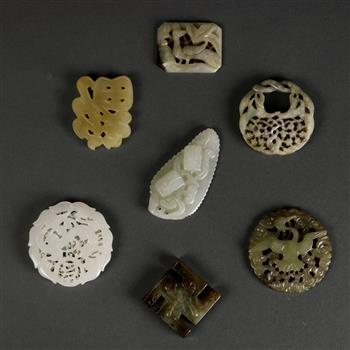 Lot 5041 - (lot of 7) Chinese hardstone toggles and plaques, including a pierced 'fu' character; three