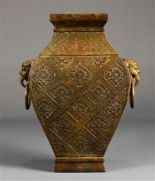 Lot 5023 - Chinese bronze hu vase, of rectangular section molded with a floral diaper pattern, flanked by