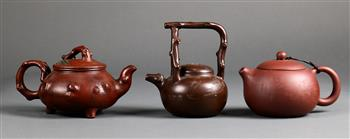 Lot 5004 - (lot of 3) Chinese zisha ceramic teapots, consisting of a plain one; the other two with branch