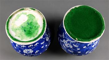 Lot 5019 - Pair of Chinese underglaze blue porcelain lidded jars, featuring prunus on a cracked-ice ground