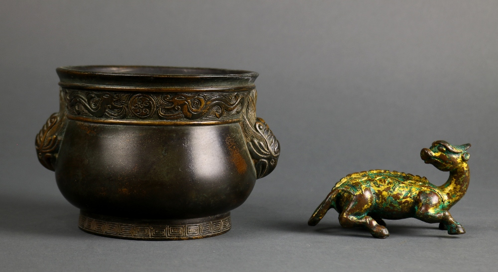 Lot 5037 - (lot of 2) Chinese bronze items: the first, a mythical beast with traces of gilt; the second, a