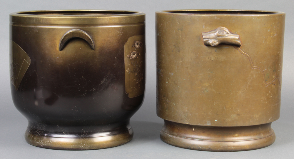"Lot 5127A - (lot of 2) Japanese bronze hibachi, cylindrical form, one etched with plum blossom, marked ""Nihon"