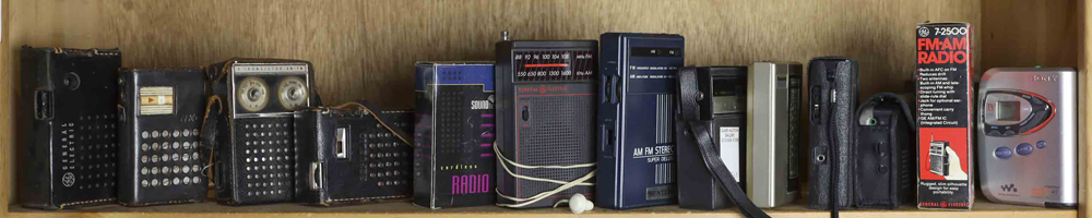 Lot 5751 - One shelf of (12) transistor radios, and (2) Walkmen, some with original boxes