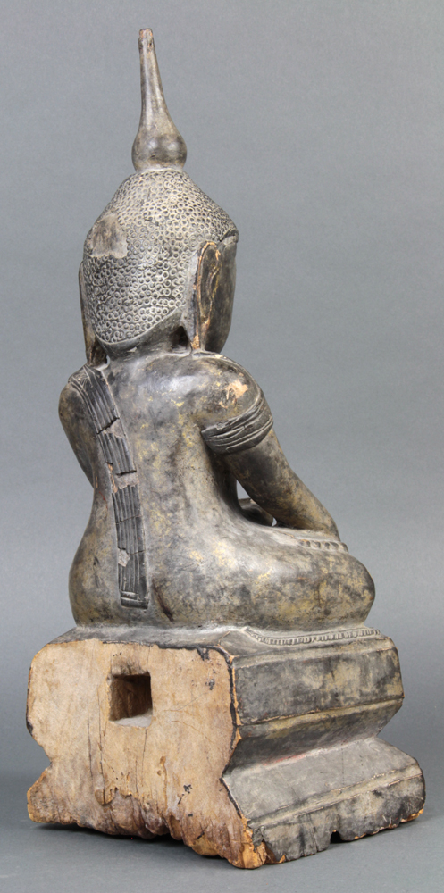 Lot 5128 - Southeast Asian wooden Buddha, seated in dhyanasana with hand in bhumisparsha mudra, above a