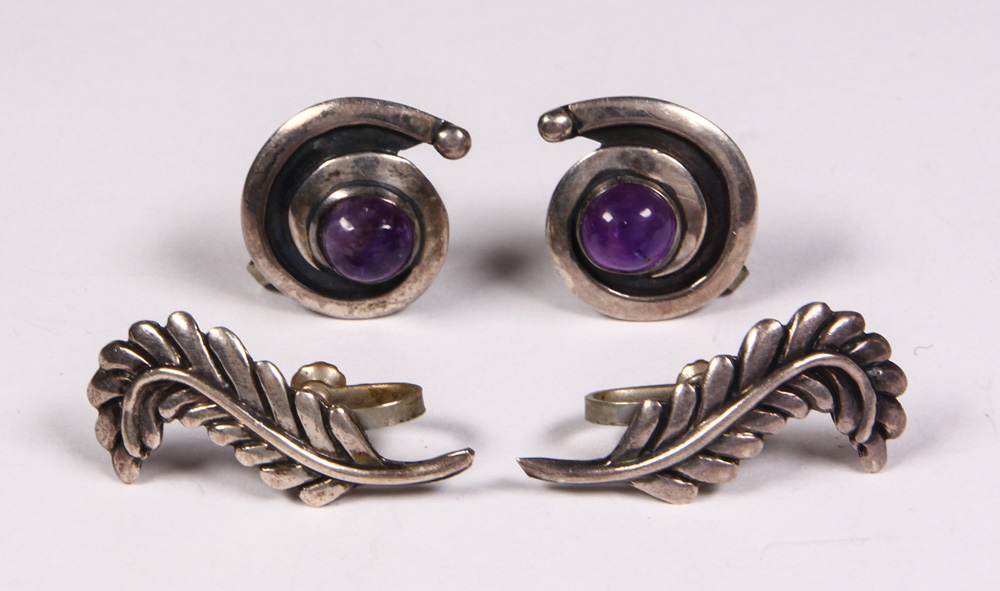 Lot 4507 - (Lot of 2) Pairs of Marciela amethyst, sterling silver and metal earrings