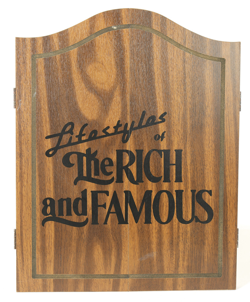 Lot 6102 - Lifestyles of the Rich and Famous dart board