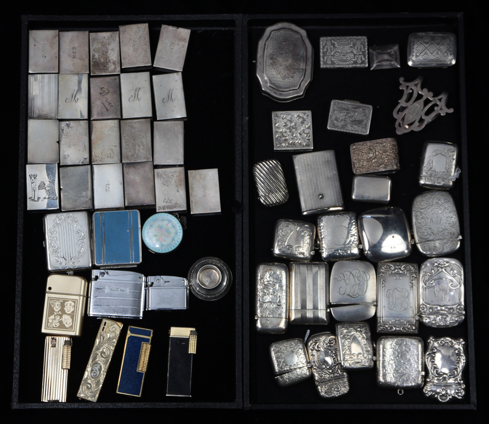 Lot 4551 - (lot of 57) Group of American and English sterling and white metal smoking accessories