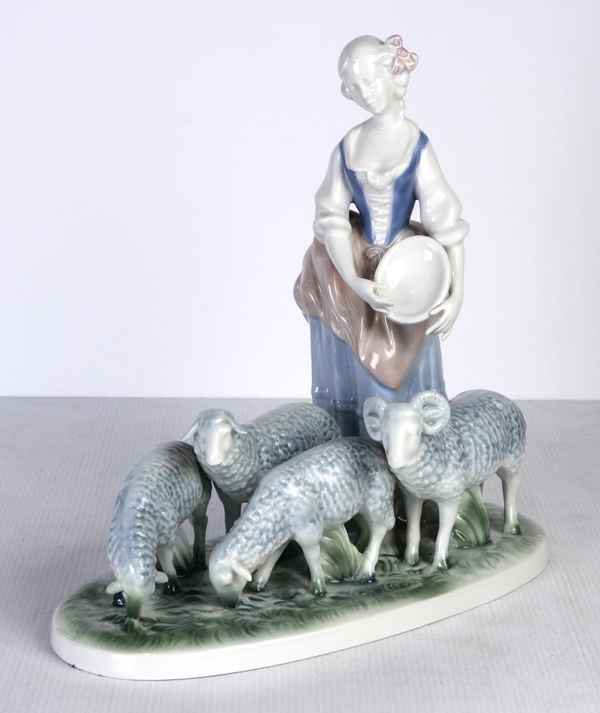 Lot 4625 - Gerald Porcelain figural group depicting a provincial girl feeding sheep