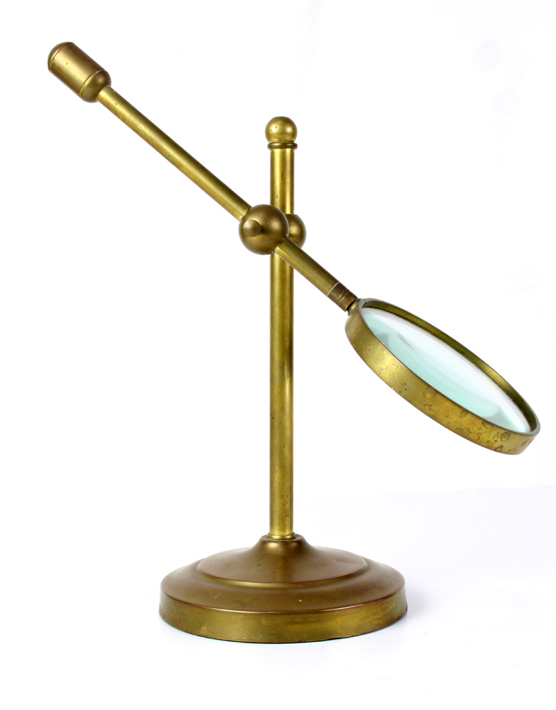 Lot 4676 - Brass magnifying glass with adjustible stand
